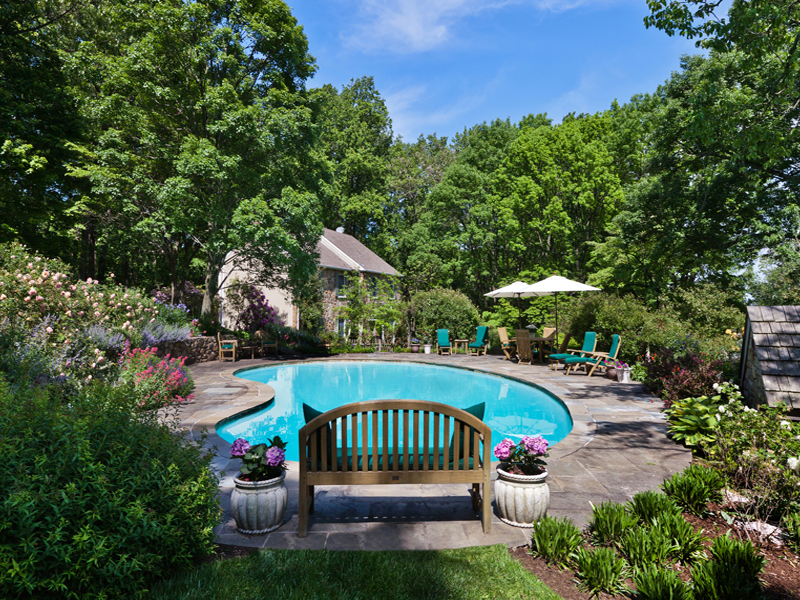 Hidden off a scenic country road, this pool is surrounded by beautifully designed gardens.